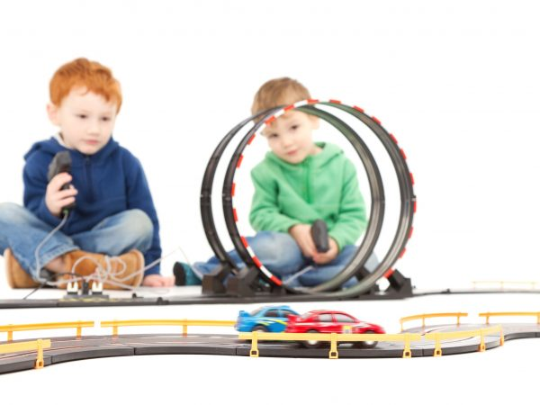 15155175 – children playing kids racing toy electric slot car game  on white